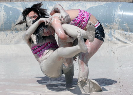 Do you have any idea how hard it is to find a SFW mud wrestling pic?  I found it here: http://news.at0086.com/Today-s-Top-News/Mud-and-guts-in-women-s-mud-wrestling-contest.html